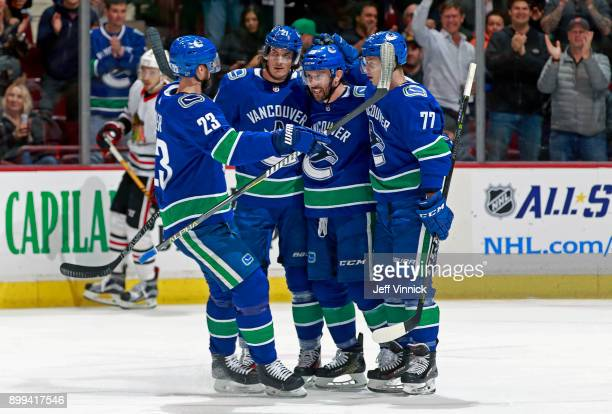 Sam Gagner of the Vancouver Canucks is congratulated by teammates after scoring during their NHL game against the Chicago Blackhawks at Rogers Arena...