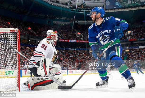 Sam Gagner of the Vancouver Canucks looks for the rebound as Anton Forsberg of the Chicago Blackhawks makes a save during their NHL game at Rogers...