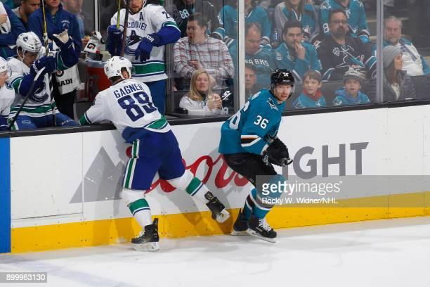 Sam Gagner of the Vancouver Canucks skates against Jannik Hansen of the San Jose Sharks at SAP Center on December 21 2017 in San Jose California