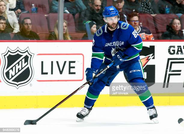 Sam Gagner of the Vancouver Canucks skates up ice with the puck during their NHL game against the Edmonton Oilers at Rogers Arena March 29 2018 in...