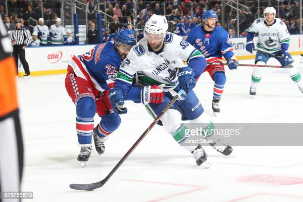 Sam Gagner of the Vancouver Canucks skates with the puck against Kevin Shattenkirk of the New York Rangers at Madison Square Garden on November 26...