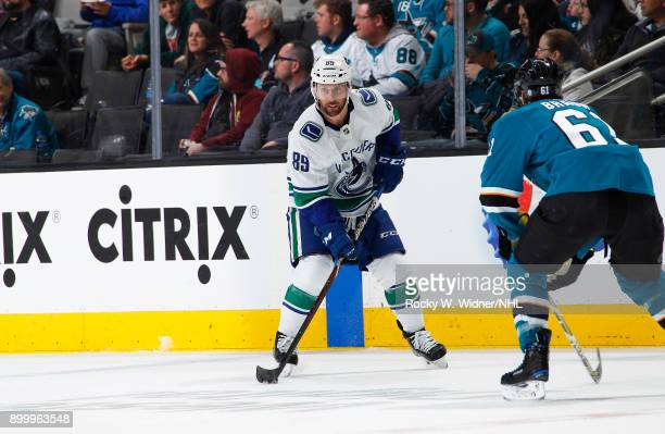 Sam Gagner of the Vancouver Canucks skates with the puck against the San Jose Sharks at SAP Center on December 21 2017 in San Jose California
