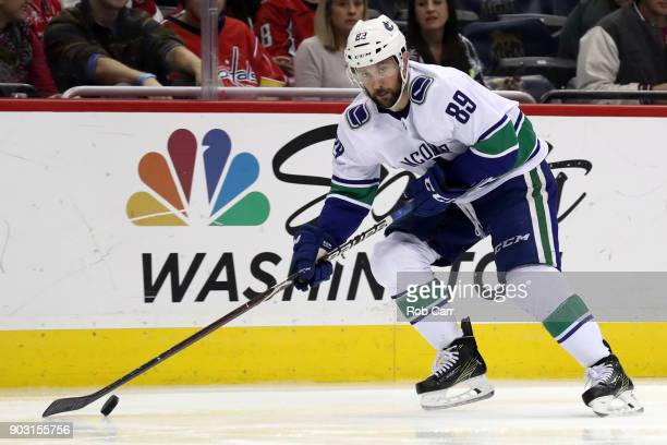 Sam Gagner of the Vancouver Canucks skates with the puck against the Washington Capitals at Capital One Arena on January 9 2018 in Washington DC