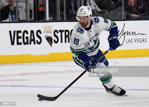 Sam Gagner of the Vancouver Canucks skates with the puck against the Vegas Golden Knights in the first period of their game at TMobile Arena on March...