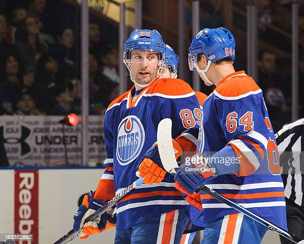 Sam Gagner talks with Nail Yakupov of the Edmonton Oilers between play against the Phoenix Coyotes during an NHL game at Rexall Place on February 23...