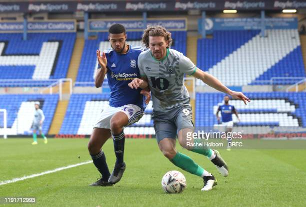 Sam Gallagher of Blackburn Rovers and David Davis of Birmingham City during the FA Cup Third Round match between Birmingham City and Blackburn Rovers...