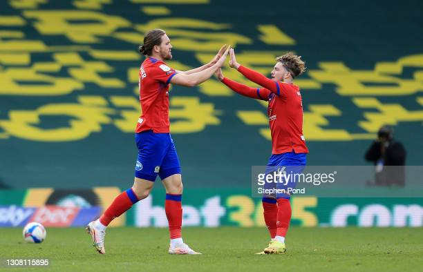 Sam Gallagher of Blackburn Rovers celebrates with Harvey Elliott after scoring their team's first goal during the Sky Bet Championship match between...