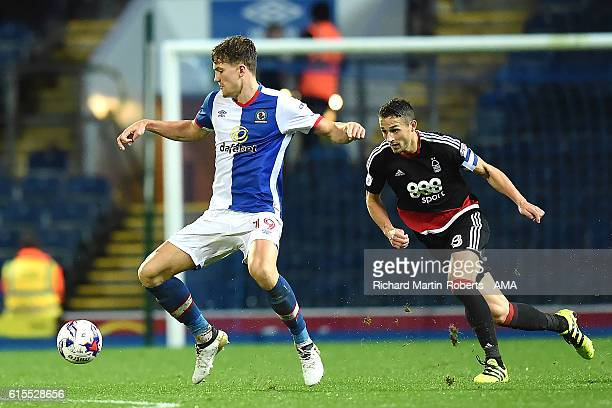 Sam Gallagher of Blackburn Rovers competes with Chris Cohen of Nottingham Forest during the Sky Bet Championship match between Blackburn Rovers and...