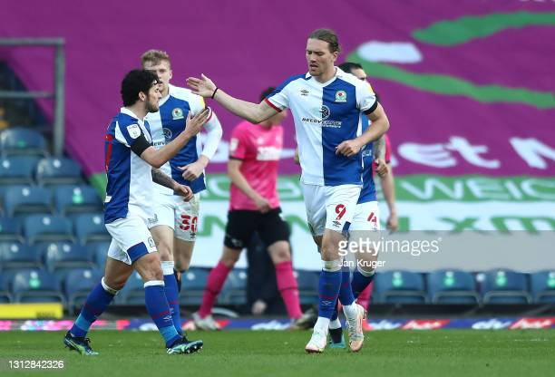 Sam Gallagher of Blackburn Rovers is congratulated after scoring a goal during the Sky Bet Championship match between Blackburn Rovers and Derby...