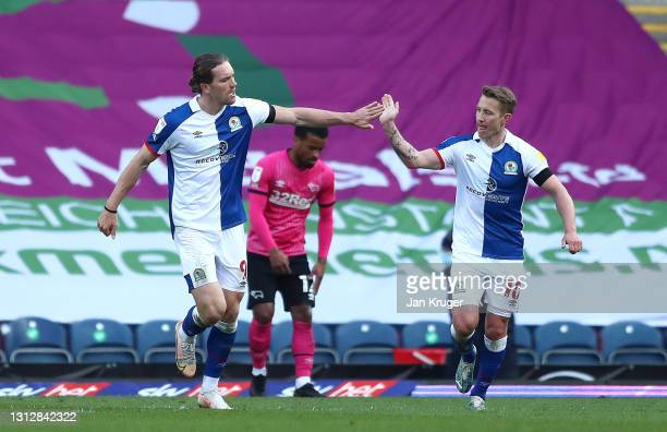 Sam Gallagher of Blackburn Rovers is congratulated by team mate Lewis Holtby after scoring a goal during the Sky Bet Championship match between...