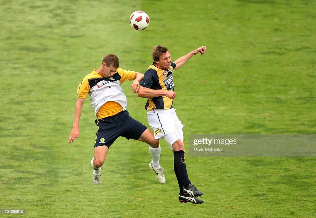 Sam Gallagher of the Young Socceroos and Patrick Zwaanswijk of the Mariners compete for the ball during the friendly match between the Young Socceroos and the Central Coast Mariners at Bluetongue Stadium on September 23, 2010 in Gosford, Australia.