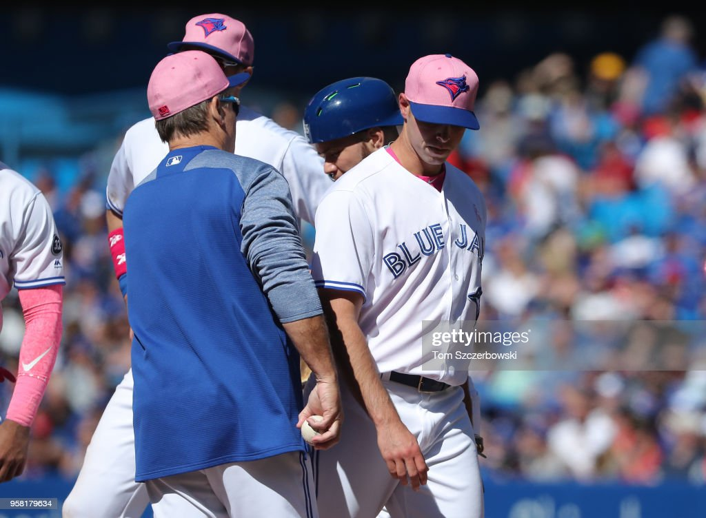 Sam Gaviglio #43 of the Toronto Blue Jays exits the game as he is relieved by manager John Gibbons #5 in the eighth inning during MLB game action against the Boston Red Sox at Rogers Centre on May 13, 2018 in Toronto, Canada.