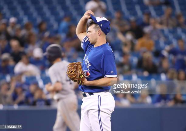 Sam Gaviglio of the Toronto Blue Jays reacts after giving up a tworun home run to Wil Myers of the San Diego Padres in the eighth inning during MLB...