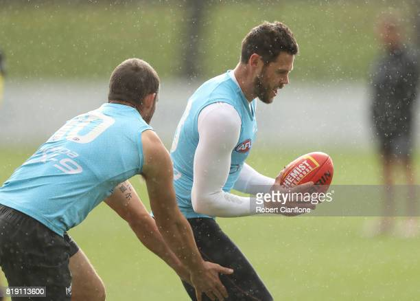 Sam Gibson controls the ball during a North Melbourne Kangaroos AFL training session at Arden Street Ground on July 20 2017 in Melbourne Australia