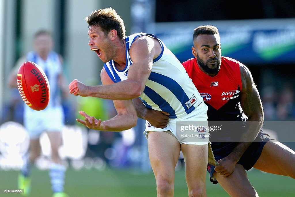Sam Gibson of the Kangaroos handballs during the round three AFL match between the North Melbourne Kangaroos and the Melbourne Demons at Blundstone Arena on April 10, 2016 in Hobart, Australia.