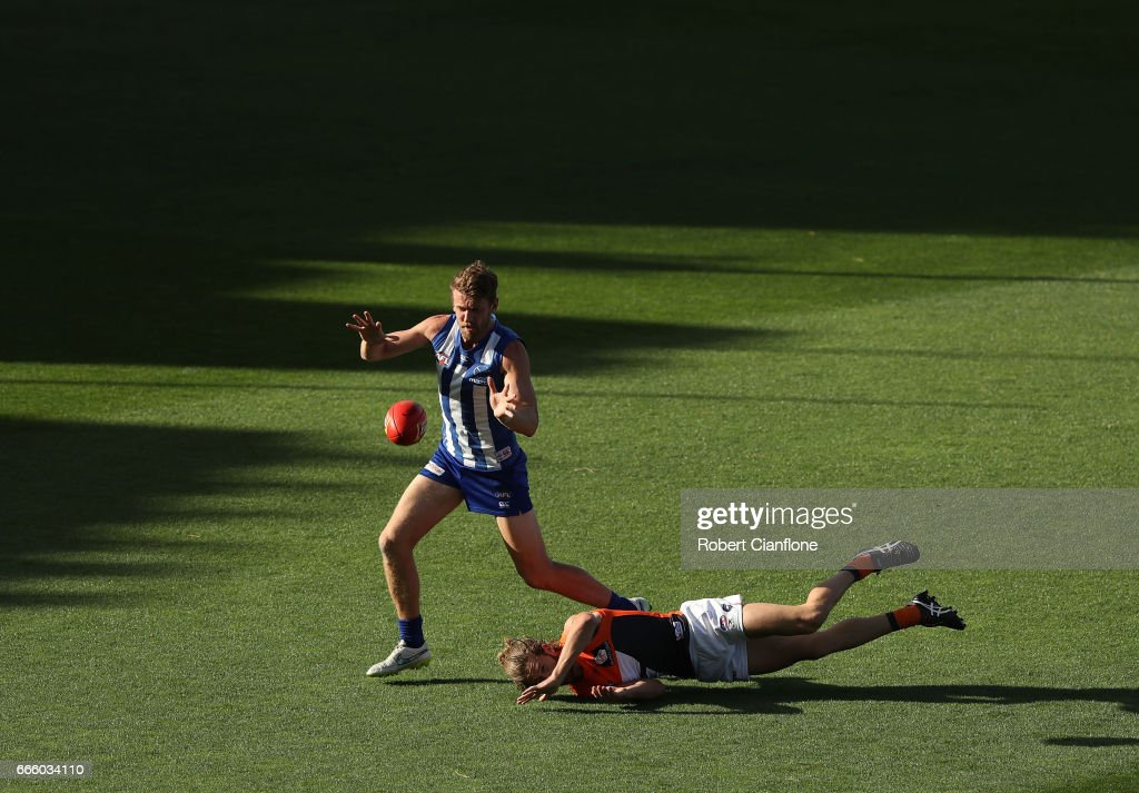 Sam Gibson of the Kangaroos is challenged by Callan Ward of the Giants during the round three AFL match between the North Melbourne Kangaroos and the Greater Western Sydney Giants at Blundstone Arena on April 8, 2017 in Hobart, Australia.