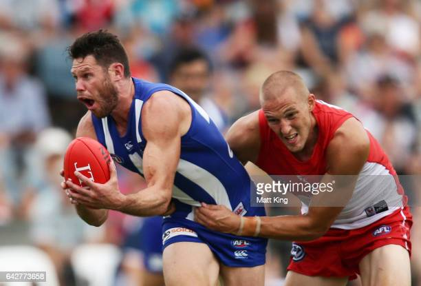Sam Gibson of the Kangaroos is tackled by Sam Reid of the Swans during the 2017 JLT Community Series match between the Sydney Swans and North...