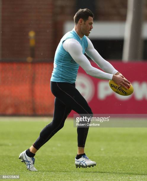 Sam Gibson of the Kangaroos runs with the ball during a North Melbourne Kangaroos AFL training session at Arden Street Ground on August 18 2017 in...