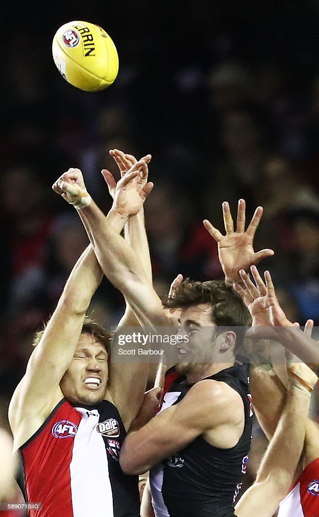 Sam Gilbert of the Saints and Lance Franklin of the Swans compete for the ball during the round 21 AFL match between the St Kilda Saints and the Sydney Swans at Etihad Stadium on August 13, 2016 in Melbourne, Australia.