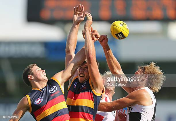 Sam Gilbert of the Saints and Ricky Henderson of the Crows compete for the ball during the round one AFL NAB Cup match between the Adelaide Crows and...