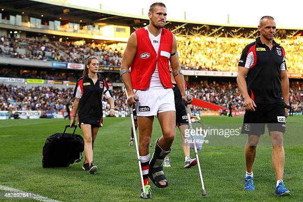 Sam Gilbert of the Saints heads to the change rooms on crutches at the half time break during the round three AFL match between the West Coast Eagles...