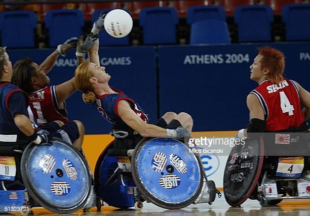 Sam Gloor of USA fights for the ball with Yashinobu Takahashi and Shimakawa Shinichi of Japan during the Wheelchair Rugby mach between USA and Japan...