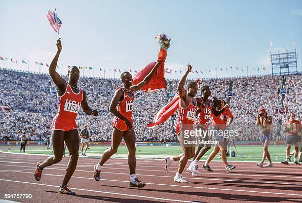 Sam Graddy Calvin Smith Ron Brown and Carl Lewis of the USA celebrate their victory in the Men's 4x100 meter relay race of the 1984 Olympic Games...