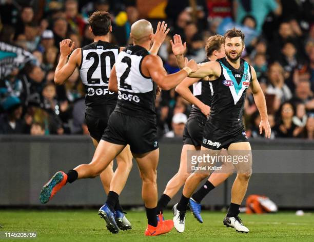 Sam Gray of the Power celebrates after kicking a goal during the round 6 AFL match between Port Adelaide and North Melbourne at Adelaide Oval on...