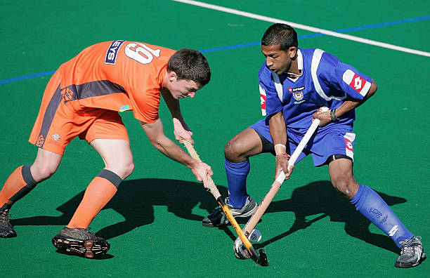 e57b600980d Sam Greenhill of Midlands (L) competes for the ball with Prasant Nathoo  during the