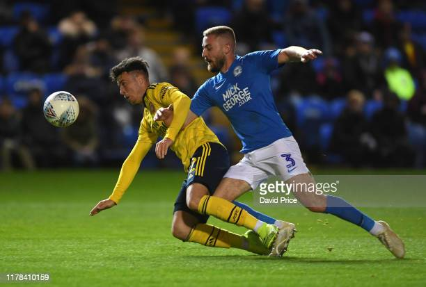 Sam Greenwood of Arsenal goes down under the challenge from Dan Butler of Peterborough during the Leasingcom Cup match between Peterborough United...