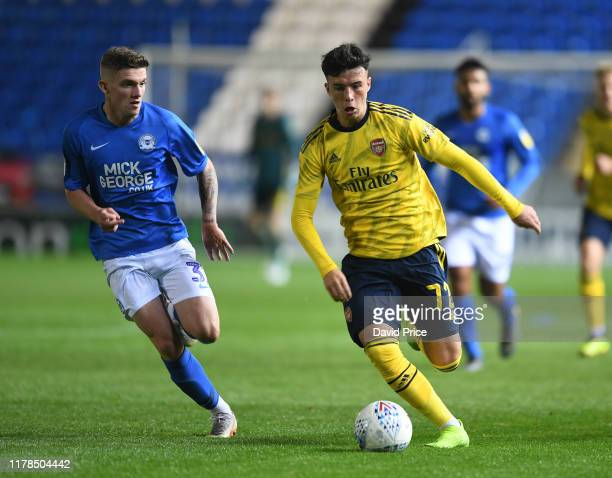 Sam Greenwood of Arsenal takes on Kyle Barker of Peterborough during the Leasing.com Cup match between Peterborough United and Arsenal U21 at Weston...