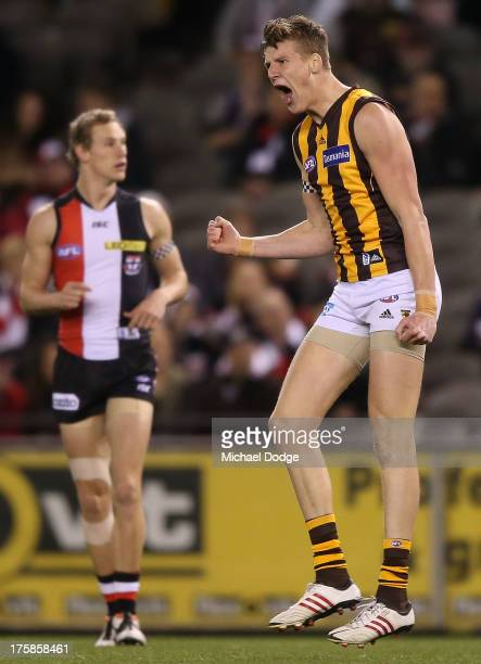 Sam Grimley of the Hawks celebrates a goal during the round 20 AFL match between the St Kilda Saints and the Hawthorn Hawks at Etihad Stadium on...
