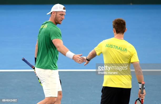 Sam Groth and John Peers of Australia celebrate during practice ahead of the Davis Cup World Group Quarterfinal match between Australia and the USA...