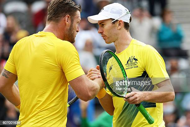 Sam Groth and John Peers of Australia celebrate winning match point in the doubles match against Andrej Martin and Igor Zelenay of Slovakia during...