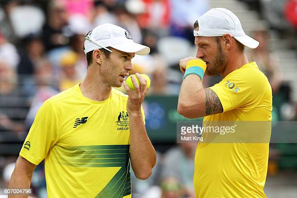 Sam Groth and John Peers of Australia talk in the doubles match against Andrej Martin and Igor Zelenay of Slovakia during the Davis Cup World Group...