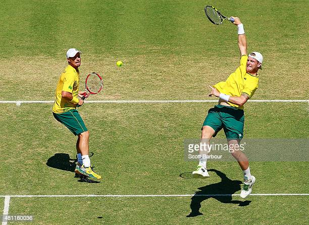 Sam Groth and Lleyton Hewitt of Australia in action as they play Andrey Golubev and Aleksandr Nedovyesov of Kazakhstan in the doubles during day two...
