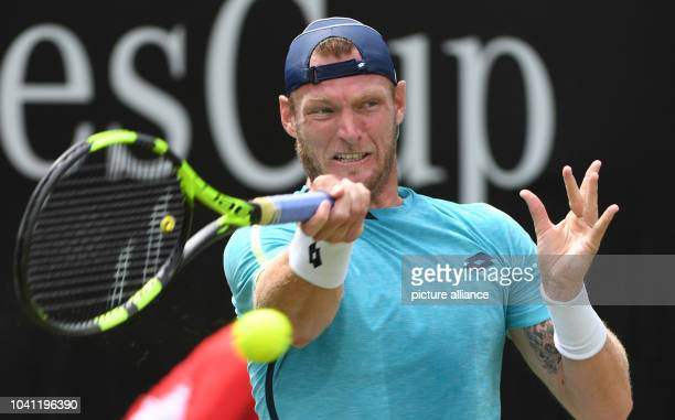 Sam Groth from Australia plays a forehand in his match against Thiem from Austria in the round of 16 at the ATP Cup at the Weissenhof inStuttgart...