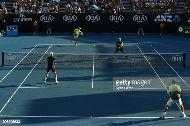 Sam Groth of Australi serves in his first round men's doubles match with Lleyton Hewitt of Australia against Denis Istomin of Uzbekistan and Mikhail...