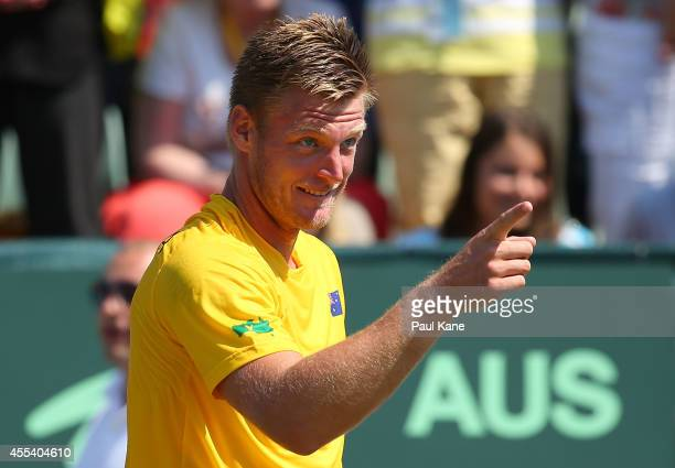 Sam Groth of Australia acknowledges the Fanatics after winning his reverse singles match against Temur Ismailov of Uzbekistan during the Davis Cup...