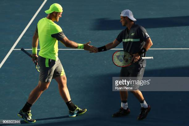 Sam Groth of Australia and Lleyton Hewitt of Australia compete in their first round men's doubles match against Denis Istomin of Uzbekistan and...
