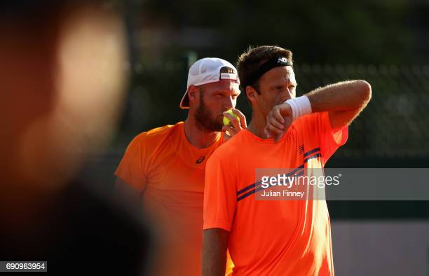 Sam Groth of Australia and partner Robert Lindstedt of Sweden speak during the mens doubles first round match against Briam Baker of The United...