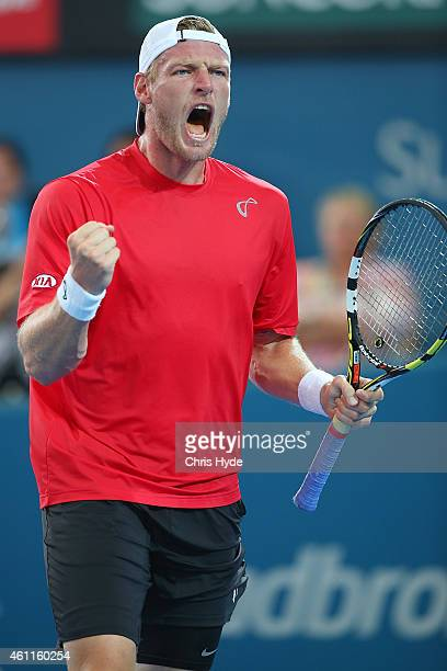 Sam Groth of Australia celebrates winning a point in his match against Lukasz Kubot of Poland during day five of the 2015 Brisbane International at...