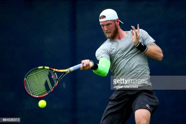 Sam Groth of Australia plays a forehand during his match against Jonny O'Mara of Great Britain during day one of Qualifying of the Aegon Open at...