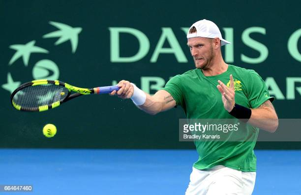 Sam Groth of Australia plays a forehand during practice ahead of the Davis Cup World Group Quarterfinal match between Australia and the USA at Pat...