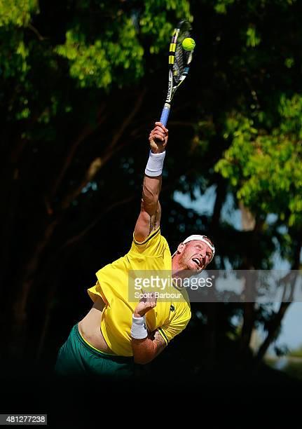 Sam Groth of Australia serves during the reverse singles match between Sam Groth of Australia and Mikhail Kukushkin of Kazakhstan during day three of...