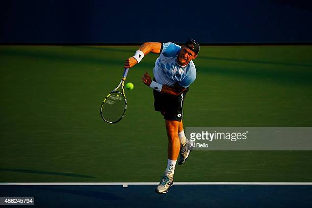 Sam Groth of Australia serves Tommy Robredo of Spain during their Men's Singles Second Round match against on Day Three of the 2015 US Open at the...