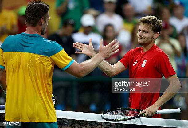 Sam Groth of Australia shakes hands with David Goffin of Belgium after his defeat in their first round match on Day 2 of the Rio 2016 Olympic Games...