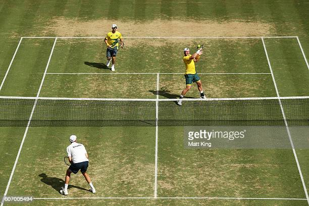 Sam Groth of Australia volleys playing with John Peers in the doubles match against Andrej Martin and Igor Zelenay of Slovakia during the Davis Cup...