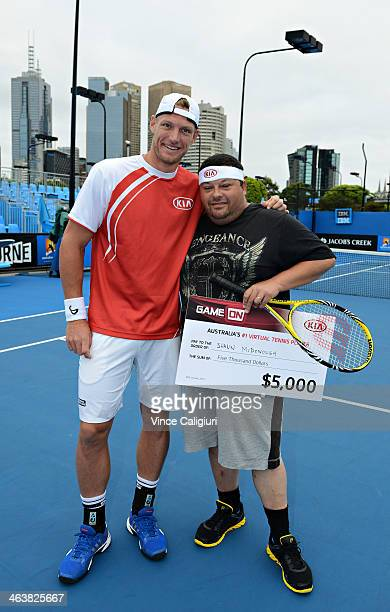 Sam Groth of Australia who holds the record for the world's fastest serve poses with Shaun McDonough the winner of the Kia 'Game On' app during day 7...