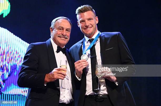 Sam Groth winner of the Newcombe Medal and John Newcombe pose on stage at the 2015 Newcombe Medal at Crown Palladium on November 23 2015 in Melbourne...